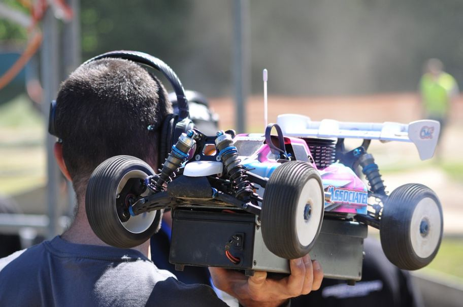 a person holding his RC buggy